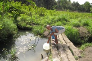 The Water Project: Polloth Village, Loco Area -  Fetching Water