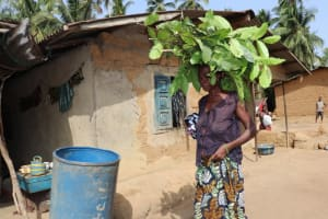 The Water Project: Polloth Village, Loco Area -  Old Woman Carrying Leaves