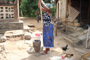 The Water Project: Polloth Village, Loco Area -  Woman Pounding Rice