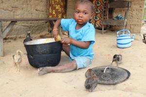 The Water Project: Kamasondo, Masinneh Village -  Kid Eating
