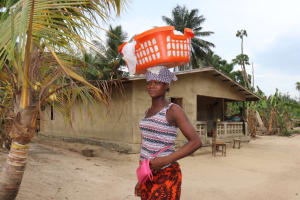 The Water Project: Kamasondo, Masinneh Village -  Woman Carries Goods For Selling