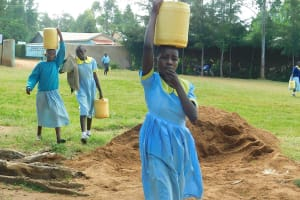 The Water Project: Hobunaka Primary School -  Students Bring Water For Construction