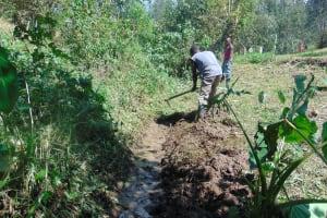 The Water Project: Mubinga Community, Mulutondo Spring -  Digging Drainage Channel