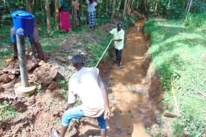 The Water Project: Kitulu Community, Kiduve Spring -  Taking Measurements Before Excavation