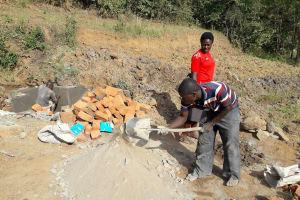The Water Project: Mwichina Community, Matanyi Spring -  Mixing Cement