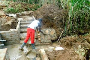The Water Project: Namarambi Community, Iddi Spring -  Rub Wall Construction