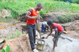 The Water Project: Maondo Community, Ambundo Spring -  Cementing The Stairs