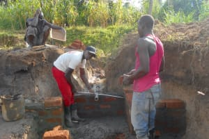 The Water Project: Kalenda B Community, Lumbasi Spring -  Setting The Pipe