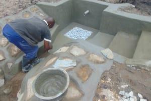 The Water Project: Bukhaywa Community, Shidero Spring -  Plastering Spring Floor
