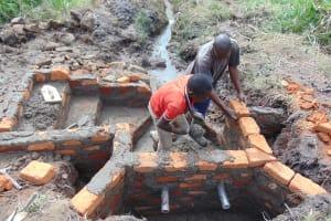 The Water Project: Emurumba Community, Makokha Spring -  Wall Construction