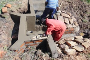 The Water Project: Mukangu Community, Metah Spring -  Cementing The Walls