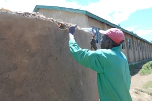 The Water Project: Bugute Lutheran Primary School -  Affixing Overflow Pipe