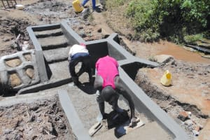 The Water Project: Kalenda A Community, Webo Simali Spring -  Plaster And Cement Work