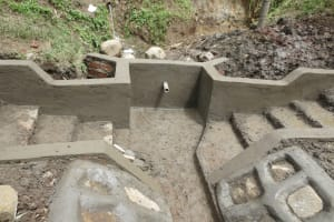 The Water Project: Rosterman Community, Lishenga Spring -  Cement And Plaster Work Underway