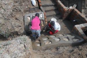 The Water Project: Kalenda B Community, Lumbasi Spring -  Rub Wall Construction