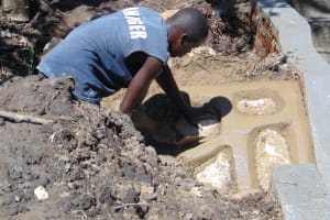 The Water Project: Mubinga Community, Mulutondo Spring -  Stone Pitching