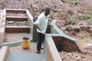 The Water Project: Kitulu Community, Kiduve Spring -  Plaster Work