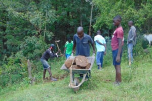 The Water Project: Mubinga Community, Mulutondo Spring -  Community Brings Stones For Backfill