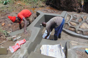 The Water Project: Maondo Community, Ambundo Spring -  Plastering And Setting Tiles