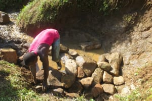 The Water Project: Rosterman Community, Lishenga Spring -  Backfilling With Stones