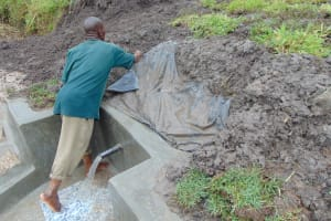 The Water Project: Bukhaywa Community, Shidero Spring -  Securing The Tarp