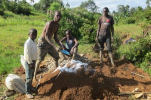 The Water Project: Tumaini Community, Ndombi Spring -  Mixing Cement