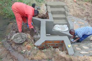 The Water Project: Mukangu Community, Metah Spring -  Plaster Work