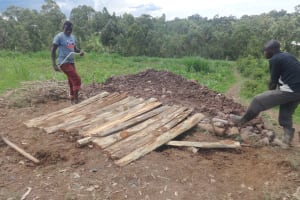 The Water Project: Bugute Lutheran Primary School -  Covering Latrine Pit