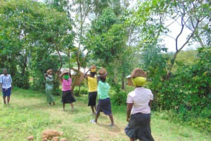 The Water Project: Maondo Community, Ambundo Spring -  Carrying Stones For Backfilling