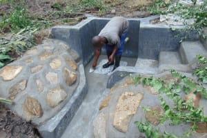 The Water Project: Emurumba Community, Makokha Spring -  Tile Setting