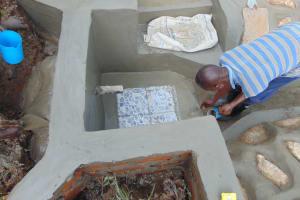 The Water Project: Mukangu Community, Metah Spring -  Tile Setting