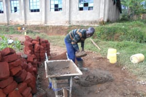 The Water Project: Bugute Lutheran Primary School -  Mixing Cement