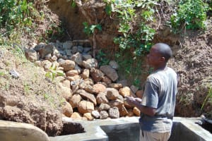 The Water Project: Mwichina Community, Matanyi Spring -  Backfilled With Stones