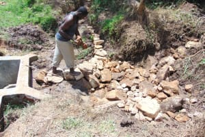 The Water Project: Mukangu Community, Metah Spring -  Backfilling With Stones