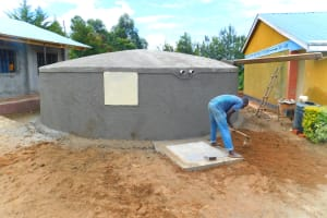The Water Project: Sawawa Secondary School -  Leveling Ground Around Tank