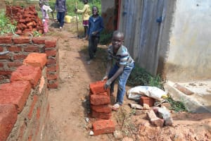 The Water Project: Bugute Lutheran Primary School -  Pupils Help Deliver Bricks