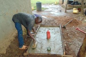 The Water Project: Musiachi Community, Mutuli Spring -  Cementing Slab