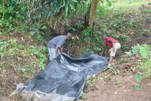 The Water Project: Mubinga Community, Mulutondo Spring -  Backfilling With Plastic Tarp