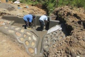The Water Project: Tumaini Community, Ndombi Spring -  Plaster Work