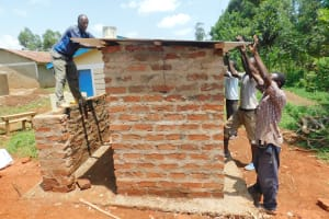 The Water Project: Bumbo Primary School -  Fitting Latrine Roof