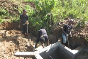 The Water Project: Tumaini Community, Ndombi Spring -  Clayworks Backfilling