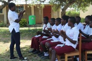 The Water Project: Friends School Ikoli Secondary -  Trainer Jemmimah Leads Handwashing Demonstration