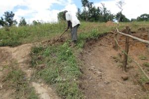 The Water Project: Kalenda A Community, Webo Simali Spring -  Digging Cut Off Drainage
