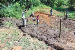 The Water Project: Maondo Community, Ambundo Spring -  Digging Cut Off Drainage
