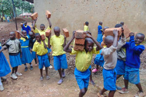 The Water Project:  Pupils Bring Bricks For Construction