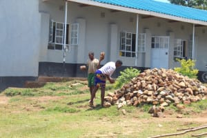 The Water Project: Bugute Lutheran Primary School -  Pupils Help Deliver Materials