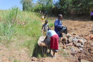 The Water Project: Mwichina Community, Matanyi Spring -  Communtiy Members Deliver Materials