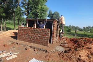 The Water Project: Chiliva Primary School -  Fitting Latrine Roof