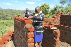 The Water Project: Bugute Lutheran Primary School -  Field Officer Janet Evaluates Progress