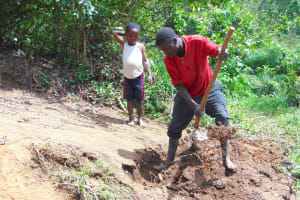 The Water Project: Mubinga Community, Mulutondo Spring -  Digging Cut Off Drainage Above Spring